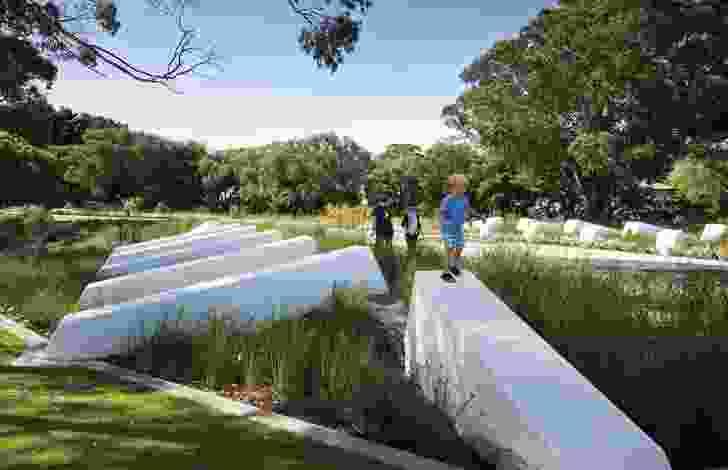 Strong geometric elements juxtapose against a swath of soft parkland.