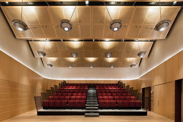 The chancery's multipurpose room in auditorium mode: imported Australian blackbutt covers the walls, floor and ceiling.
