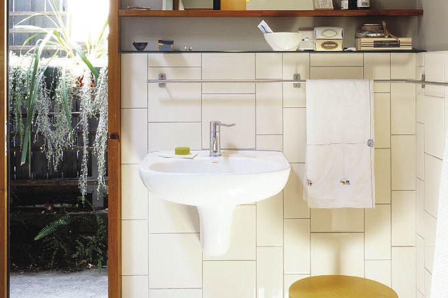 Johnson Alabaster tiles and Caroma Integra 500 wall basin.
