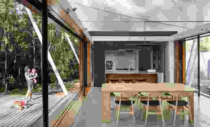 Exterior glass walls slide away and the roof, which is motorized and track mounted, can be stacked away to completely open the living area.