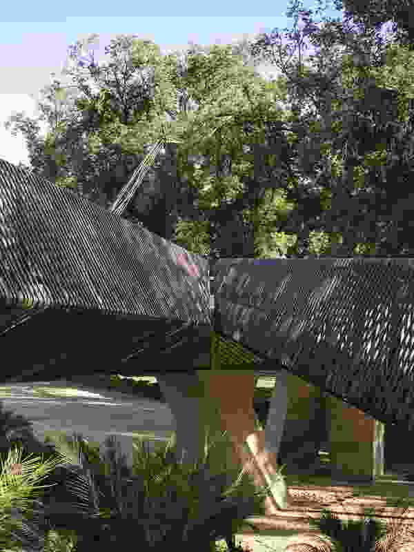 "Tanderrum Bridge designed by John Wardle Architects and NADAAA is made from a flat steel girder structure encased in concrete and wrapped in a ""filigree"" skin."