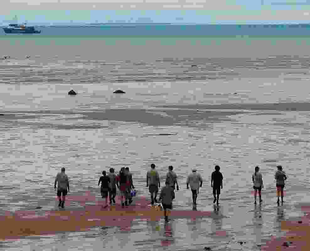 Yawuru Rangers head out to sea grass, Roebuck Bay.
