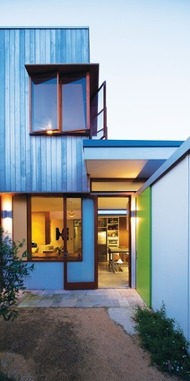 The exterior palette mixes fibre cement sheet cladding with shiplapped Western red cedar.