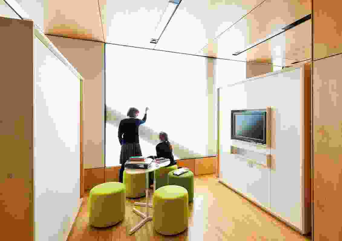 The translucent polycarbonate facade permits light into the flexible working spaces.