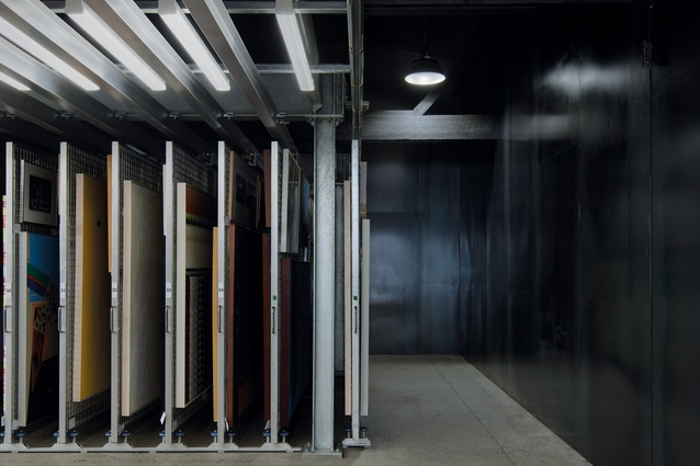The art archive sits within one half of the sawtooth shell of the existing warehouse.