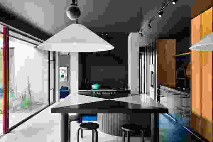 The proportion and bold lines of the bespoke kitchen table anchor social activity in the home.