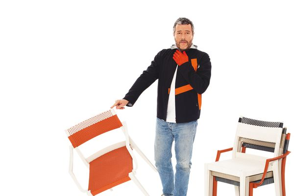 Philippe Starck pictured in a promo shot for his Play chair collection. Starck is a talented designer with the business and marketing nous to back it up.