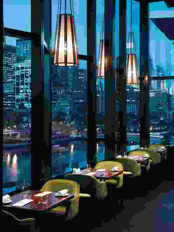 Through five-metre-high windows, diners look out to the twinkling lights of Melbourne city and the Yarra River.