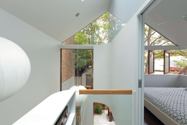 Glazing up to the gable expands and lightens the upstairs section.