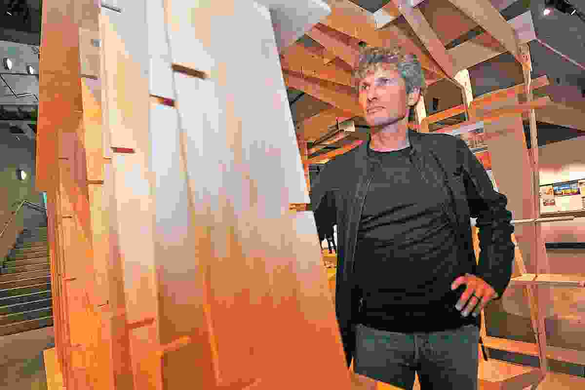 Chris Moller in front of his installation for Kiwi Prefab at Puke Ariki.