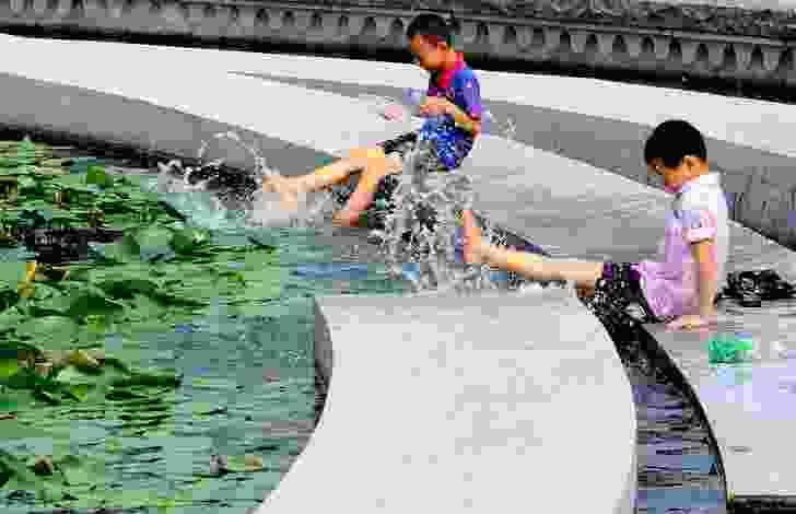 Children splashing in water, Zhangjiagang Town River Reconstruction by Botao Landscape.