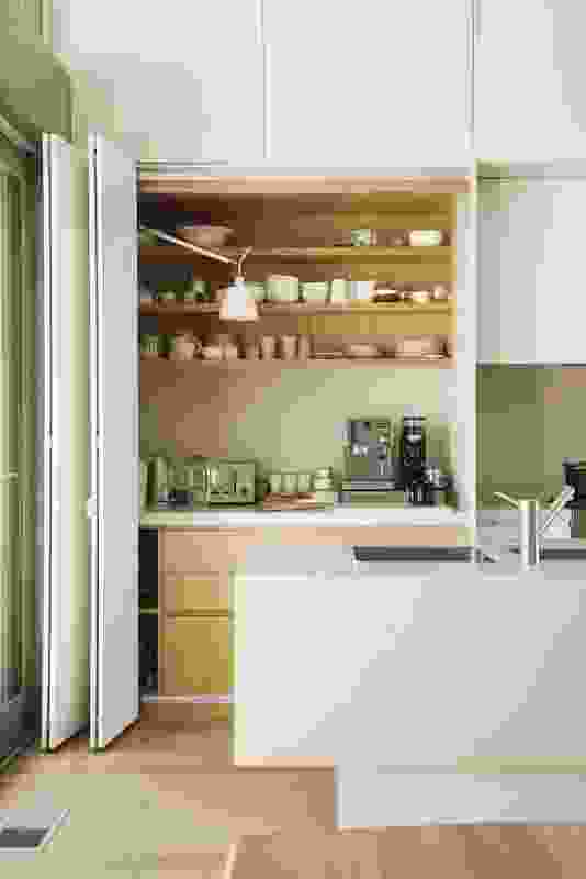 A bank of full-height joinery houses food preparation and extra storage.