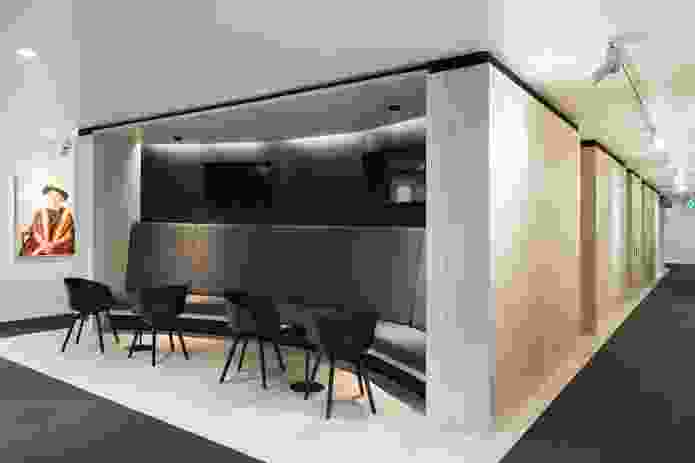 The timber box has been scooped out at the rear to accommodate banquette seating. Artwork: Portrait of Dr Sylvia Walton AO by Jaun Ford (2011).