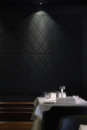 Black wall panelling adds to the sophisticated surrounds.