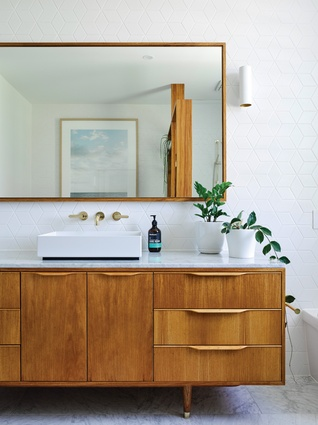 Fine timber detailing with a modernist aesthetic is applied to bathroom joinery.
