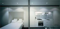 The bedroom area is tucked behind a sliding screen wall that can be opened up to the living space. Image: Brett Boardman