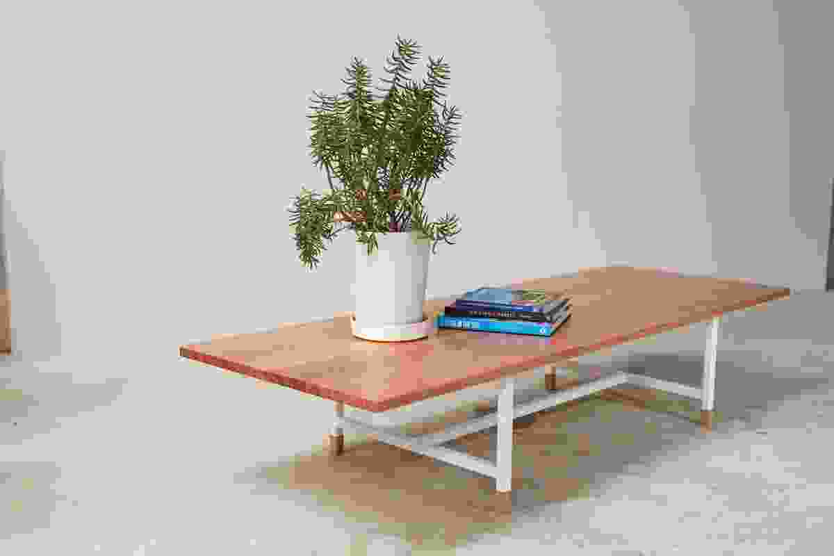 The KW range includes a coffee table made of solid timber or plywood with a powdercoated steel base.