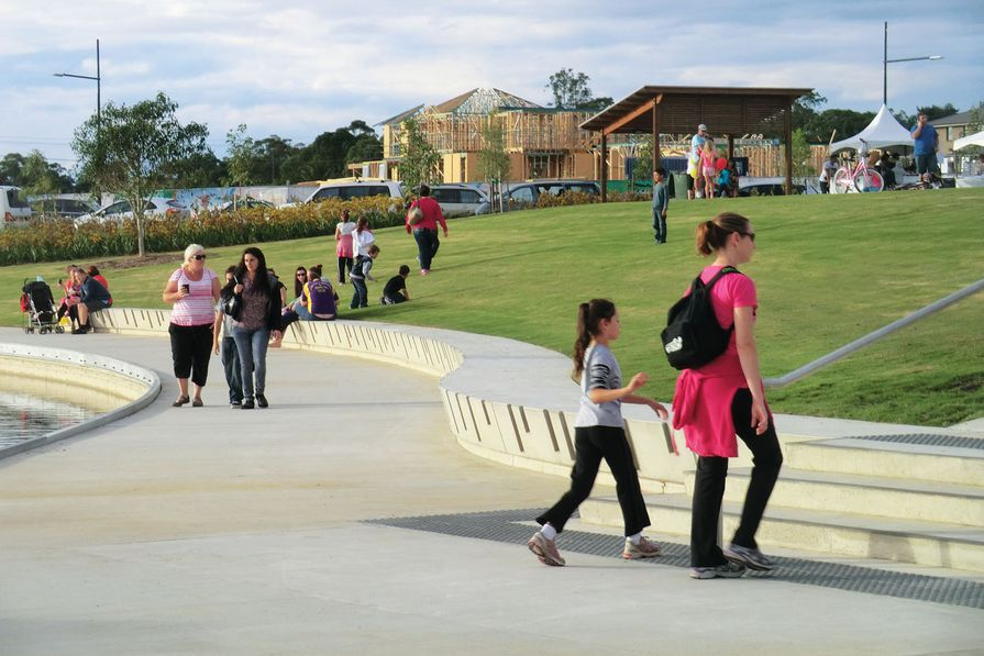 Robust seating walls, lawn embankments and park facilities have created a popular new waterfront.