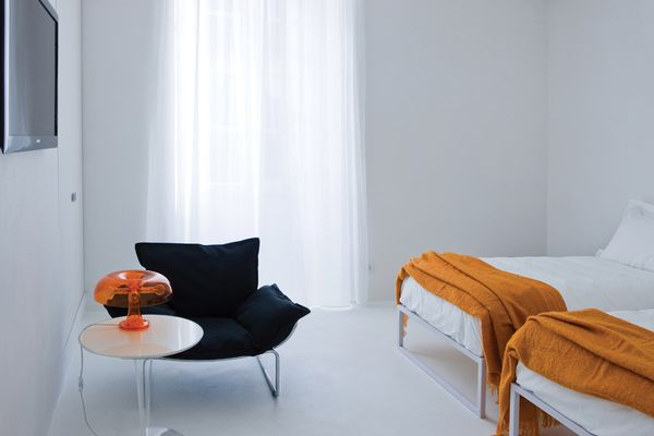 The lighting and mood in the rooms is dramatic, with some in bright white and some in grey shadows.