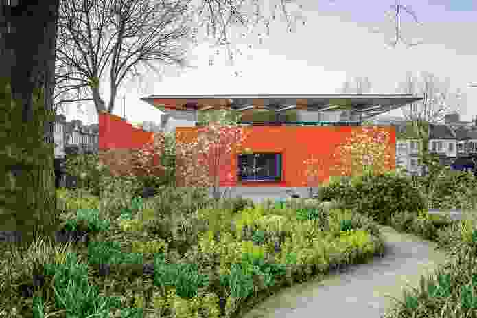 The lushly planted public courtyard at the Maggie's Centre London creates a sheltered, therapeutic sanctuary for patients and visitors to meet, talk and relax
