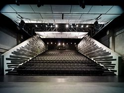 The first row of seats is level with the stage.