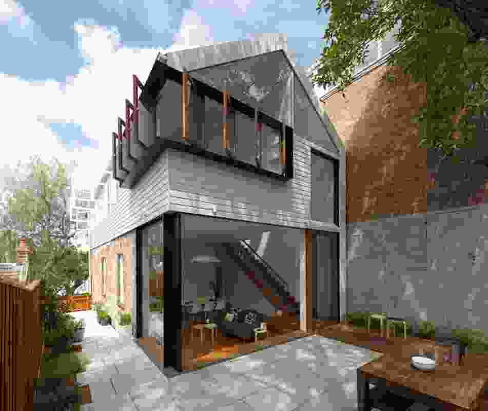 The main bedroom overhangs the combined kitchen/living space below.