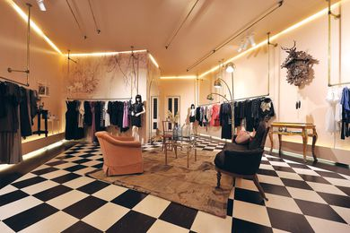 The main space with pink-nude-coloured walls and black-and-white chequerboard floor.