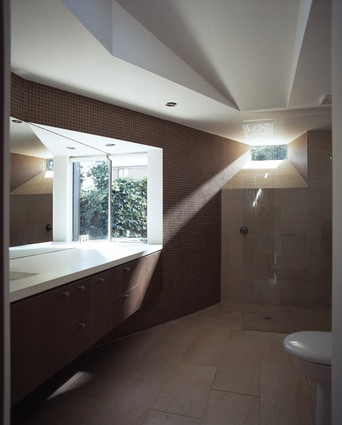 The new ensuite features a north-facing pop-out window that reaches out to the sunlight.