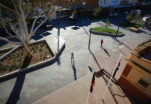 The design of Victoria Square transforms a section of a town's main street into a pedestrian-friendly gathering place and thoroughfare.