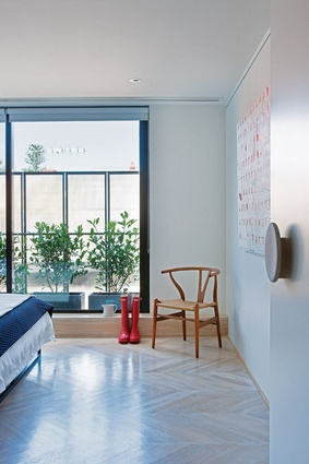 Juliet balconies off the bedrooms allow air and light to filter through the rippled glass panels.