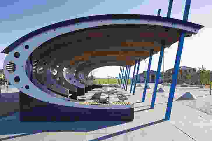 A bold park shelter continues the ongoing aeronautical themes found in the estate.