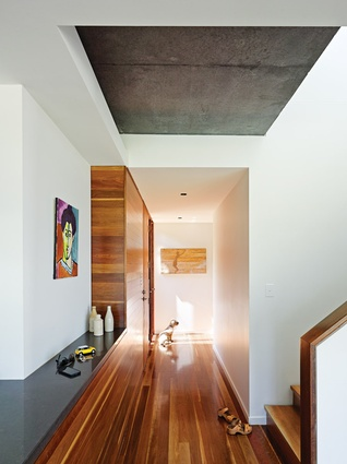Spotted gum flooring and feature walls balance with off-form concrete. Artwork: Felix Gallagher.