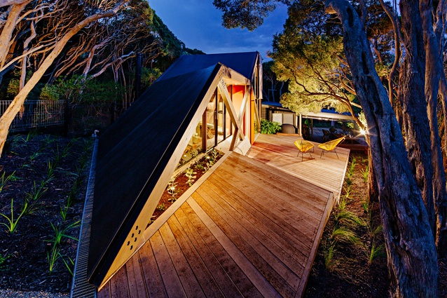 The sloping roof form is inspired by the topography of the site.