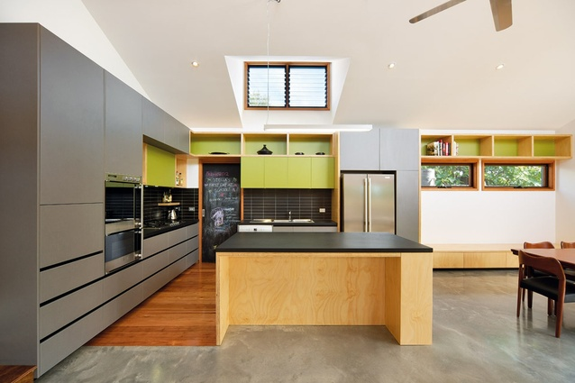 Joinery in muted greys and greens in the open kitchen.