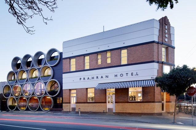 Reinvigorated with a bold facade new rear facade of industrial concrete pipes stacked like kegs or barrels.