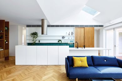 The kitchen island functions as the home's backbone, around which everyday activities take place.