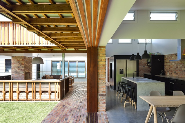 The L-shaped plan opens to generous garden courtyards, a forest and an outdoor room.