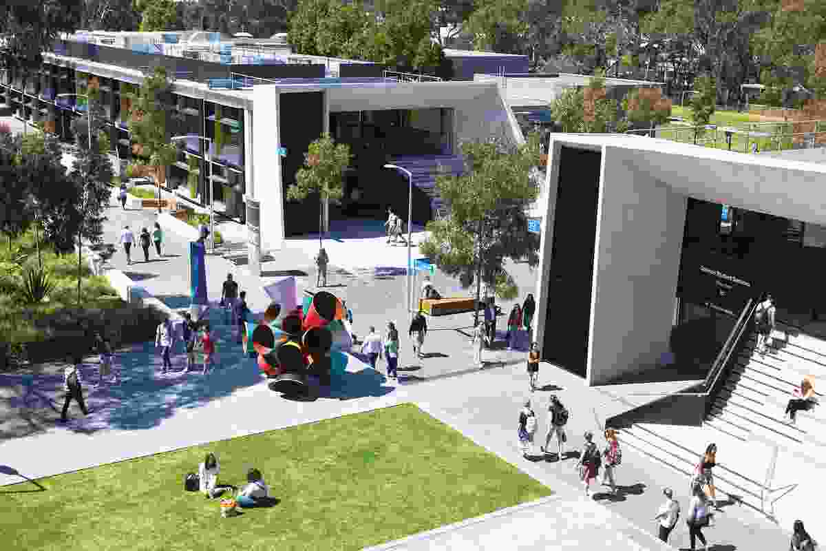 Students stroll through the North West Precinct at Monash University's Clayton campus, designed by Outlines Landscape Architecture.