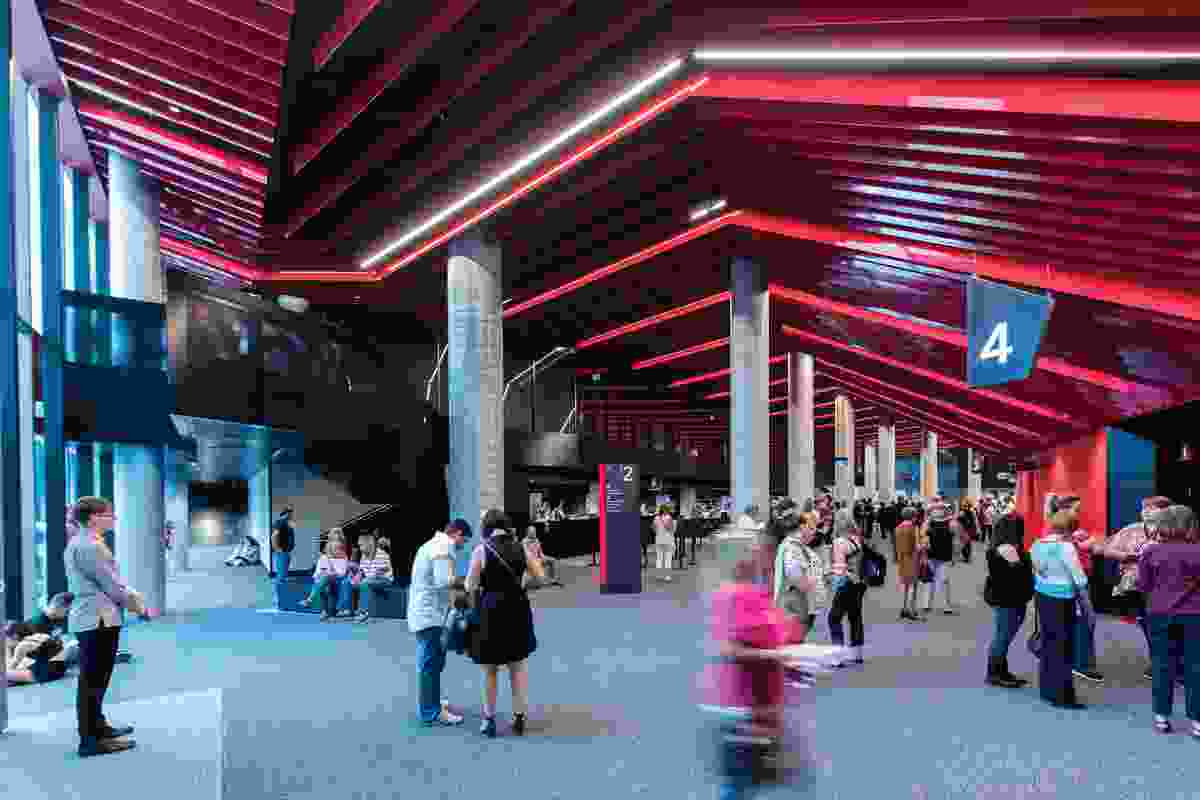 The dramatic red of the main foyer reflects the signature colour of the ICC Sydney Theatre.