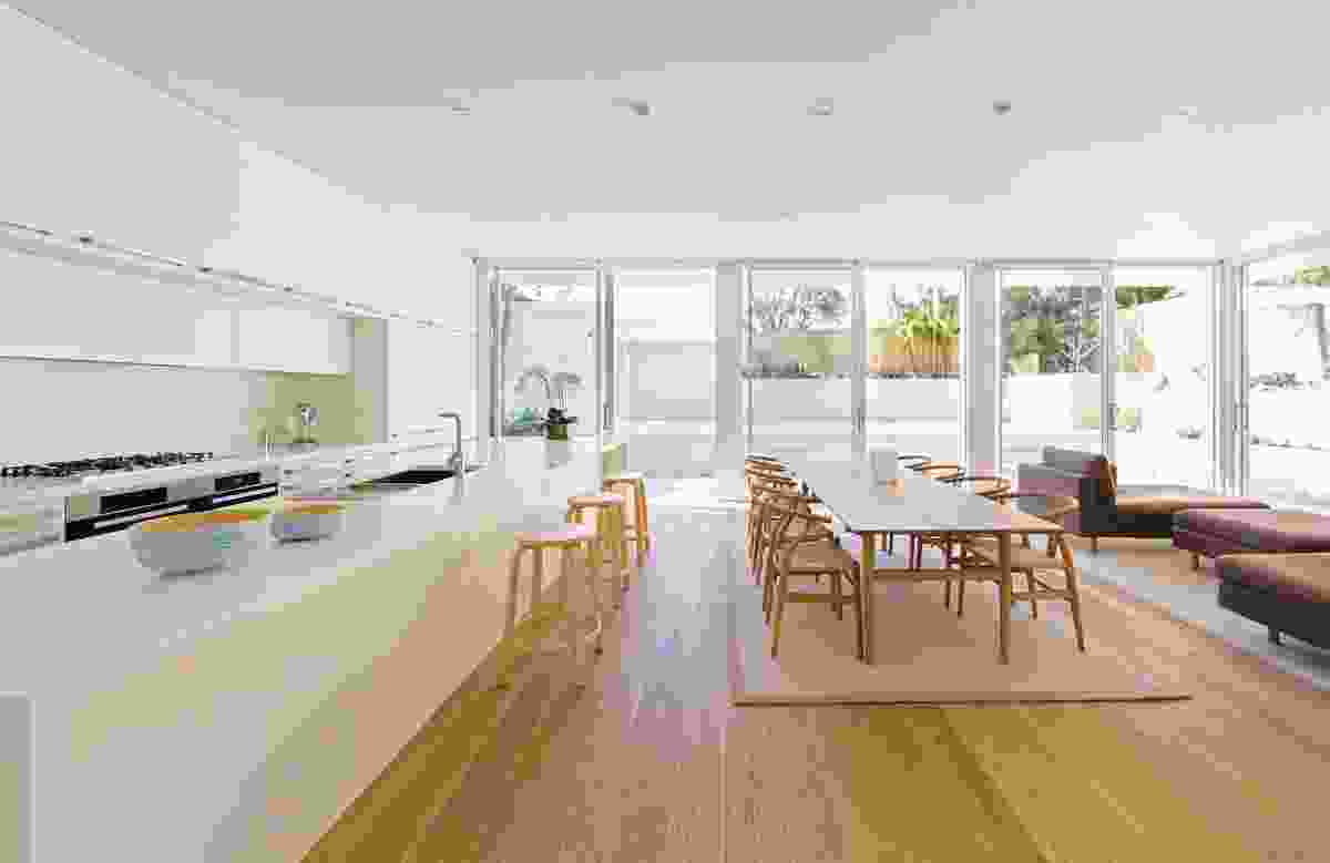"""The new living area """"box"""" frames views of the garden, sky and neighbouring trees and opens onto the backyard."""