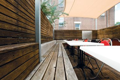 The outdoor deck dining features reclaimed timber benches.