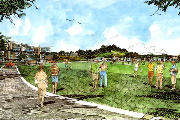 The recreation oval that will form the centre of the new community, with the peak of Big King visible at top right.