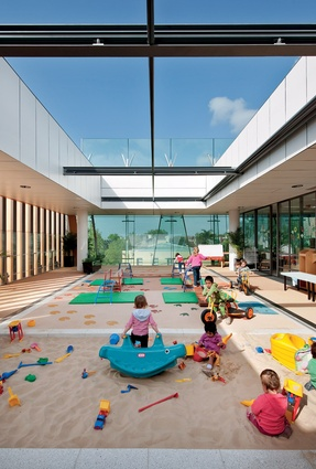 The childcare centre on level 2 includes an open-air play area.