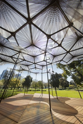 The 2015 MPavilion designed by Amanda Levete creates a pattern of shadows on the ground.