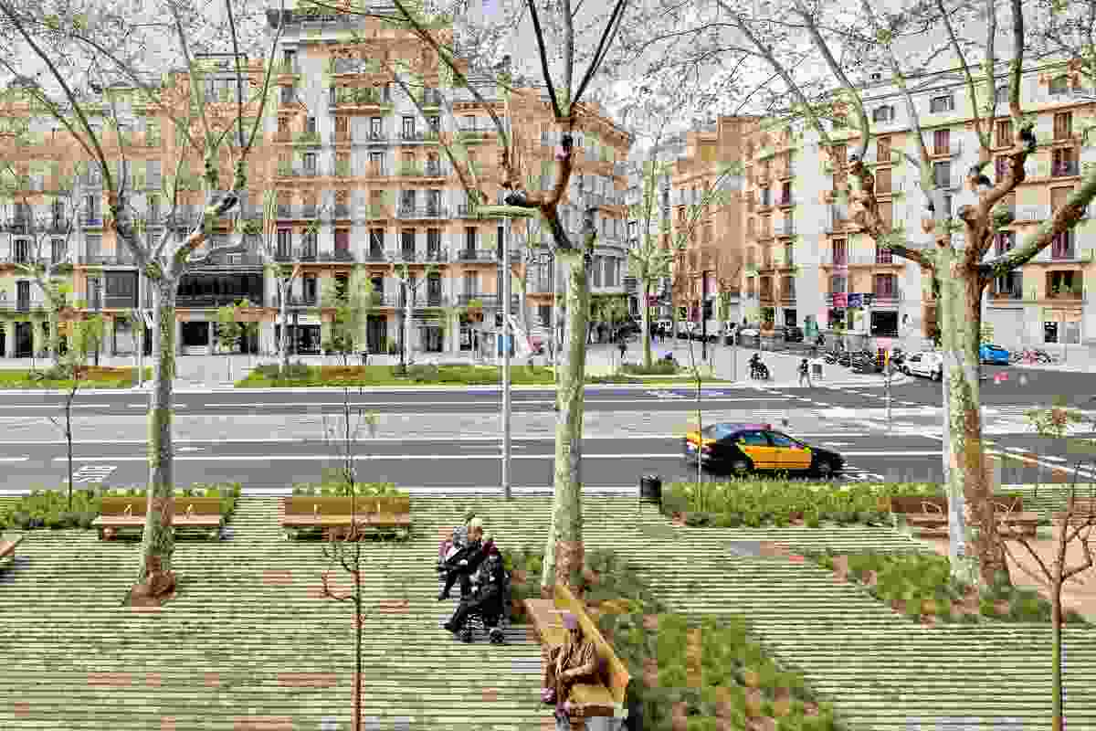 Working with architect Lola Domènech, Arquitectura Agronomia transformed a sidewalk in Barcelona with a permeable paving of concrete and grass.