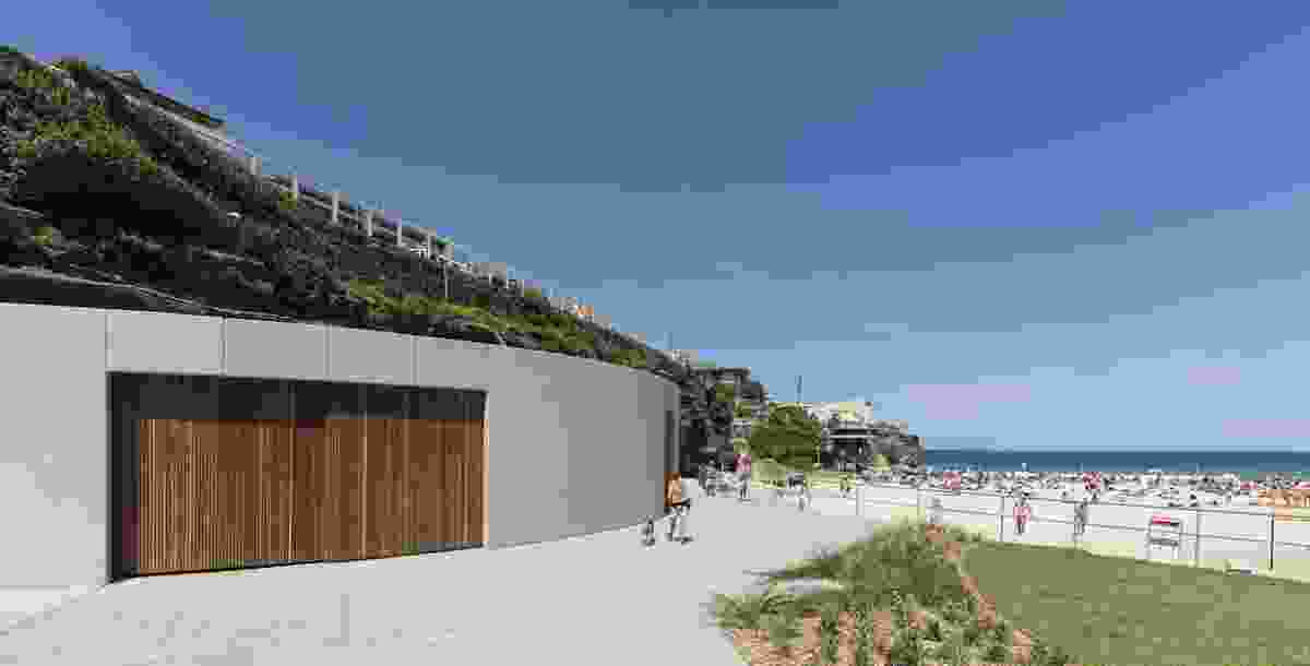The site of the old kiosk is now a curved concrete storage pod for the Tamarama Surf Life Saving Club.
