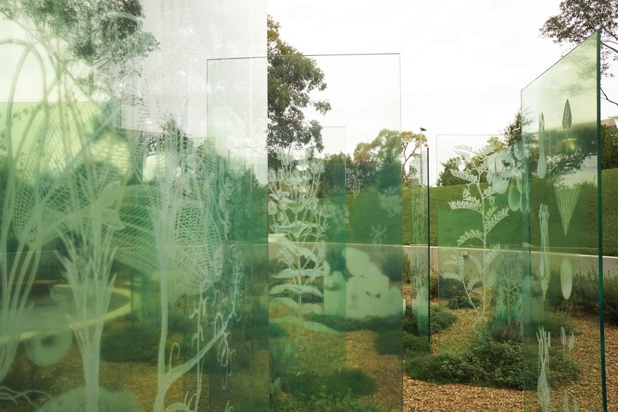 A formal grid of glass panels acts as both veils and screens in the garden, presenting and preserving memories.