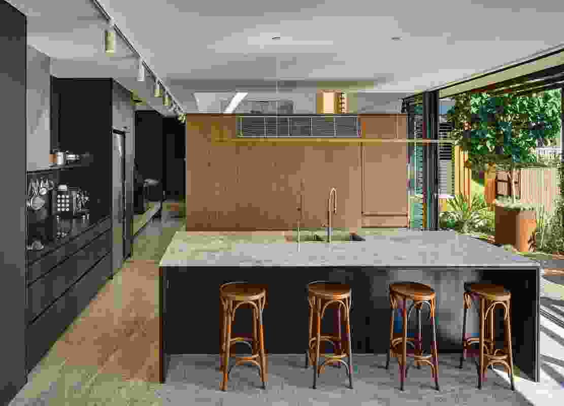The kitchen and dining areas are oriented to exploit the views and seamlessly connect with the garden.
