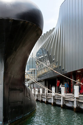 "The bulging form of the building and its ""raw"" detailing and materials are reminiscent of naval architecture."