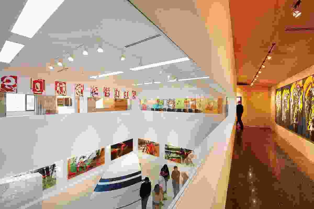 The double-height white cube gallery. Artworks: Rose Nolan, Rose Nolan 2000/2001, 2000–2001 (far left, upper floor); Patricia Piccinini, Sheen, 1997–1998 (ground floor); Jim Paterson, The Elephant Man (I–V), 1989 (far right, upper floor).